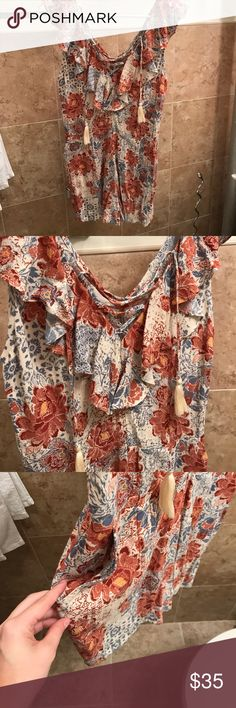 Kendall and Kylie floral romper Floral romper with pockets and lace up detailing on neck line. Never worn but no tags. Zipper closure. Neckline ruffles Kendall & Kylie Pants Jumpsuits & Rompers