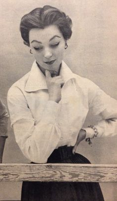 Hubert de Givenchy- 1952 In a Cuban style- white button down blouse with ruffle details down the front and around the upper arms. Elle Les Collections Printemps 1952- March 2, 1952