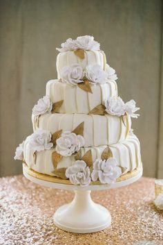 Elegant pleated wedding cake with white roses and golden leaves. Photography By / http://delbarrmoradi.com,Planning By / http://soireebysimone.com