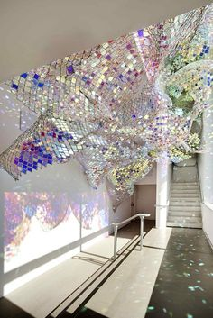 Capturing Resonance: Soo Sunny Park and Spencer Topel at DeCordova Museum, Lincoln, MA - iridescent Plexiglass tiles inserted into a chain link fence