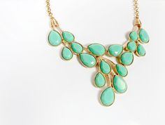 Make a statement!  A mint green statement necklace can dress up even the most casual of outfits! Wear it with a simple white T-shirt and jeans or add it to your favorite spring dress.