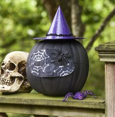 Turn a faux pumpkin into a witch in this sparkly pumpkin craft project! The best part is that you can reuse the fake gourd when you're done. Design by MichaelsMakers DIY Candy