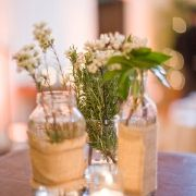 jars with baby's breath, sunflowers, lavender, and herbs.