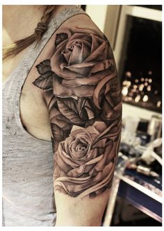 Rose tattoo - upper arm - by John Lewis of Life & Death Tattoos