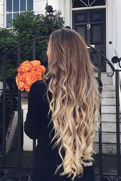 long curly hairstyle | with hair extensions | ombre | dark root | blonde