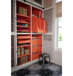 Custom storage units with pull-out shelves will provide easy access to your supplies. Instead of using white, go for a fun punch color such as tangerine tango, which is Pantones 2012 Color of the Year.