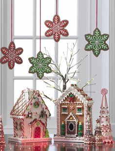 Snowflake cookies over gingerbread houses and candy trees