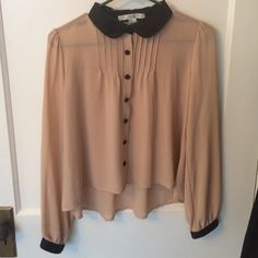 Chiffon button down It is a cropped sheer top, with the chest pleated and silk buttons, wrist cuffs, and collar. Forever 21 Tops Button Down Shirts