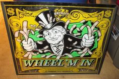 BROMLEY WHEEL 'M IN REDEMPTION GAME CABINET BACKGLASS / ARTWORK, GUC #BROMLEY