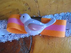 Purple, Orange and Pink headband with a bird by mikisimms on etsy. I'm in love with this one! :)