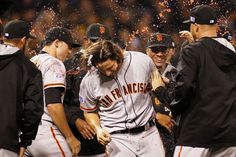 PITTSBURGH, PA - OCTOBER 01: Madison Bumgarner #40 of the San Francisco Giants celebrates with teammates after the defeated the Pittsburgh Pirates 8 to 0 in the National League Wild Card game at PNC Park on October 1, 2014 in Pittsburgh, Pennsylvania. (Photo by Justin K. Aller/Getty Images)