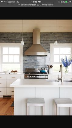 For a dramatic moment in the kitchen, designer Sarah Richardson offset the time-worn shiplap ceiling with a wall of contemporary Moonstone mosaic tile. Contemporary Kitchen Backsplash, Modern Kitchen Design, Kitchen Designs, Shiplap Ceiling, Ceiling Decor, Sarah Richardson Kitchen, Basement Colors, White Kitchen Island, Kitchen Islands