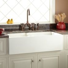 The Risinger Offset Bowl Fireclay Farmhouse Sink is a great piece for your kitchen remodel. This sink features a casement front, which adds subtle elegance to its classic design. Highly durable and easy to clean, the Risinger is a great addition Cast Iron Farmhouse Sink, Farmhouse Apron Sink, Stainless Steel Farmhouse Sink, Fireclay Farmhouse Sink, Copper Farmhouse Sinks, Farmhouse Style, White Farmhouse, Modern Farmhouse, Kitchen Sinks For Sale