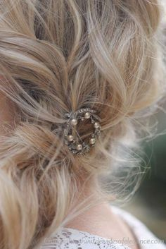 Messy side ponytail with a vintage brooch from Decades of Elegance