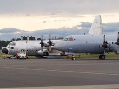 USAF LC-130 and RAAF Orion at Christchurch airport  Type: Lockheed LC-130H Hercules, Lockheed AP-3C Orion Registration: 83-0491, A9-656 Location: Christchurch International Airport Date: 15/09/2012