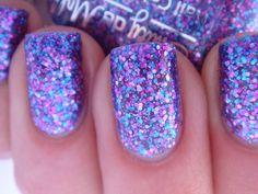 "Nail polish - ""Warrior Princess"" pink, blue and purple glitter in a sheer purple base."