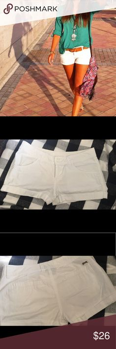 """Le TIGRE SHORTS Every girl needs white shorts in their closet. 8.5"""" from waist to hem, 1.5"""" rise, 2 button and zip closure and cuffed hem. These cute shorts also have side and back pockets and the well known """"La Tigre"""" logo on the back. No stains. Size 5, will fire size 4/6 Le TIGRE Shorts"""
