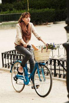 Love the large scarf and simple jean and jacket. Beautiful Blue bike too! Great autumn style.