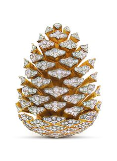 Pine cone brooch by Fulco di Verdura. My inspiration to use ultra fine glitter with glue on que tip & dazzle a real pine cone to hang on tree or decorate bowl