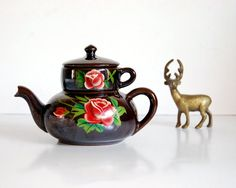Such a sweet vintage redware stacking teapot and cup (circa 1940s)