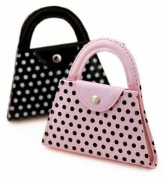 Manicure Set in Polka Dot Purse by HansonEllis. $12.92. Do your nails anywhere you go with this adorable, easy to carry purse favor. Each polka dot purse comes with 6 tools. Set includes nail clipper, nail filer, mini mirror, tweezers, scissors, and cuticle tool.
