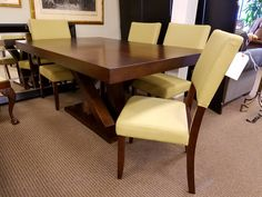 Another great modern chic look! This pedestal expresso dining table is priced at only $399 and these green upholstered dining chairs are only $79 each.