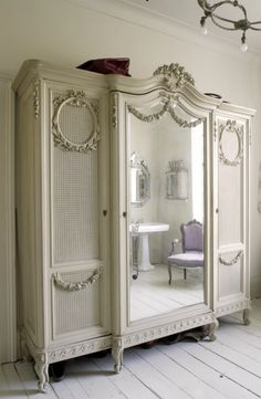 armoire- I am a big fam of mirrored closet doors, but these would work as well!