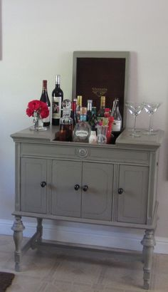 Antique Victrola cabinet becomes a bar w/ a fresh coat of milk-paint