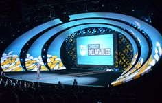 Stage design with large swoosh architecture; Projection Mapping at Turner Upfront 2014 | Atomic Design