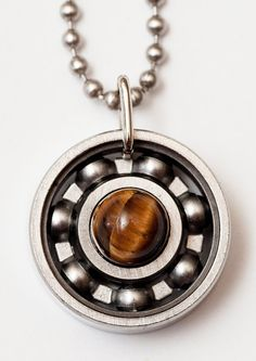 New year, new you? Get a jumpstart with tiger's eye! Tiger's eye is useful for finding your personal power, strengthening your willpower and motivation to achieve goals, looking at the positives instead of the negatives, as well as giving a creative boost to your life. Sounds good to us! #derbygirldesigns #bearingjewelry #jewelrythatrocks #newyear #newyou #tigerseye #pendantjewelry #personalpower #willpower #motivation #allaroundgoodstuffs
