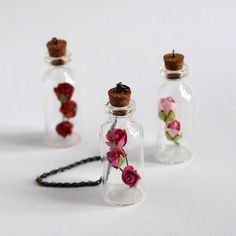 Three Tiny Bottle Pendant with Rose by Oldism. Bottle Jewelry, Bottle Charms, Bottle Necklace, Clay Charms, Bottle Art, Mini Glass Bottles, Small Bottles, Bottles And Jars, Glass Jars
