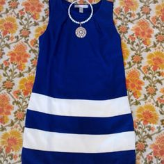 FOREVER 21 BLUE & WHITE DRESS Adorable sleeveless blue and white dress has exposed gold side zipper. super cute! Keyhole opening at center bust. Fully lined Shell 100% Polyester Lining 100% Polyester Machine wash and Line dry Forever 21 Dresses