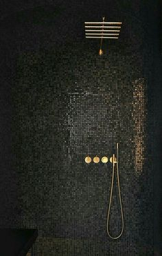 CONTEMPORARY vibe from black mosaic tiles cantilevered black seat simple lines minimalist look. GLAM factor from glossy-finished gray mosaic tiles that reflect light gold-finished rain shower & shower controls. Black Shower, Gold Shower, Black Tiles, Wet Rooms, Bathroom Interior Design, Black Interior Design, Contemporary Interior, Luxury Interior, Beautiful Bathrooms