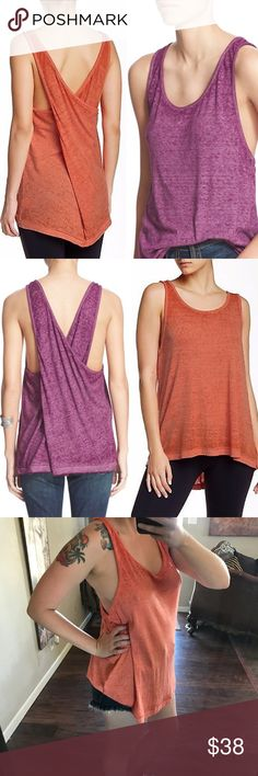 """Set of 2 New Free People """"Break of Dawn"""" Tanks Set of two (2) ultra soft purple and orange/red heathered tunic tanks by Free People/We the Free. """"Break of Dawn"""" criss cross back style. Oversized, both are size medium. I am a typical small modeling the orange one in the final picture so you can see the fit. ✨New without tags! ✨You can purchase these individually in my closet, but buying them together is an even better deal! 🛍 Free People Tops Tank Tops"""