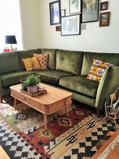 boho rug green vintage midcentury style corner sofa, pineapple lamp, cushions