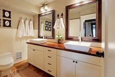 contemporary bathroom with white vessel sinks