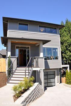 Retro Modern Four Square House.  Portland.  Gray House.  Glass Garage Door.  Modern Farmhouse.  Front Porch.