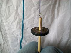 how to use a spindle...  (for newspaper yarn project)