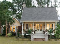 """If you were to peruse my ideabook titled ""Becky's faves,"" this is the first picture you would see. It absolutely exemplifies cottage style. A wide and welcoming porch stretches its arms toward the street, urging you to come in and visit."""