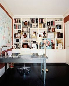 Cool Office with Black Floors+ Awesome Cool Marble Desk Top+ Built -in Bookcase+ Pretty Painting and Skull Art