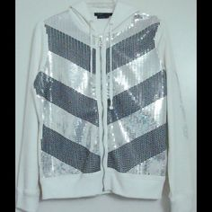 BCBG MAX AZRIA White Sequin Black Silver Hoodie Brand: BCBG MAX AZRIA. Material: 95% Cotton / 5% Spandex. Style: Hoodie Pattern: Chevron. Size Type: Regular Color: Cream Size (Women's): Large. Sleeve Style: Long Sleeve. LAST ONE BCBGMaxAzria Tops Sweatshirts & Hoodies