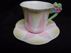 RARE PINK TALL DAINTY FLORAL HANDLE CUP AND SAUCER ARE IN PRISTINE CONDITION