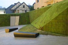 herzog de meuron prada tokyo building court yard moss on mesh covering stone