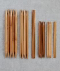 purl soho   products   item   double pointed bamboo knitting needles (crystal palace) Set includes 5 double pointed knitting needles. These needles are manufactured by a small firm in Japan who have been making fine bamboo products for more than 80 years. The needles are resin treated and cured to harden them and to prevent warping, splitting and damage from insects.