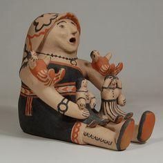 "#adobegallery - Female Storyteller with Shawl and 4 Kids. Seferina Ortiz (1931-2007)      Category: Figurines     Origin: Cochiti Pueblo     Medium: clay, pigment     Size: 8"" height x 9"" depth x 7-1/8"" width     Item # 25815"