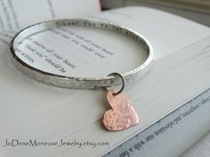 Personalized hand stamped bangle with a hand cut heart charm dangle $99.00 by JoDeneMoneuseJewelry