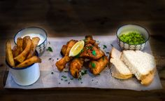 Quintessential beer battered fish with homemade triple cooked chips, minted mushy peas & tartar sauce.