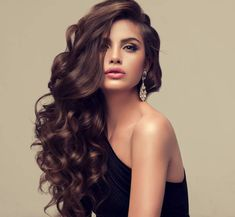 Young attractive brunette with voluminous, shiny and curly hairstyle. stock photo #braidedhairstylesboho