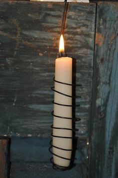 Handmade Wire Candle Holder; probably DIY. It would be a neat decoration for a cellar or unfinished basement.