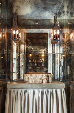 A powder room with antiqued mirroring, designed by Talbot Cooley